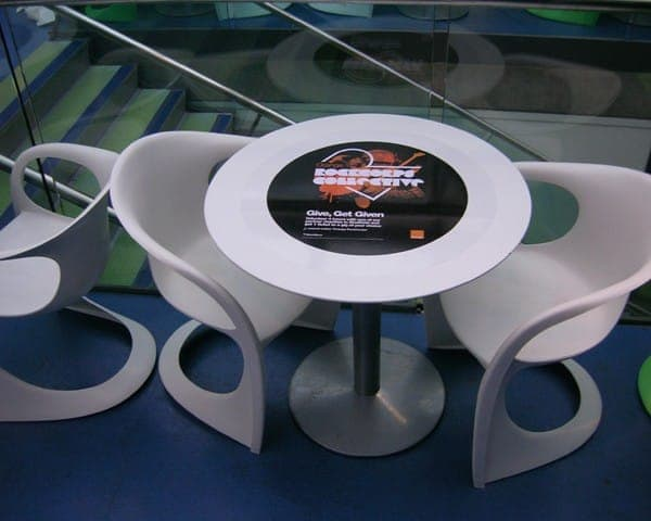 orange rockcorps tablewrap table advertising media coffee culture university network