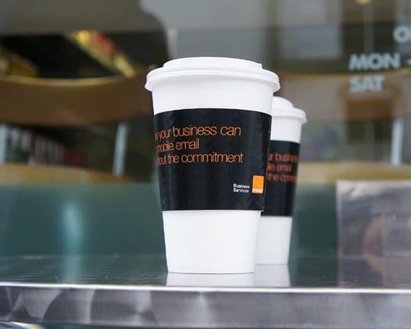 orange coffee cup coffee sleeve advertising media
