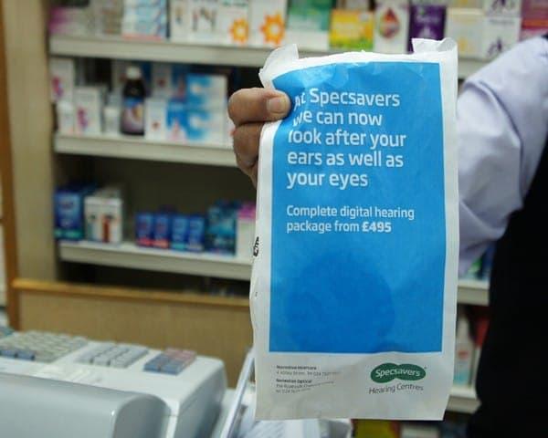 specsavers pharmacy bag advertising media bag media
