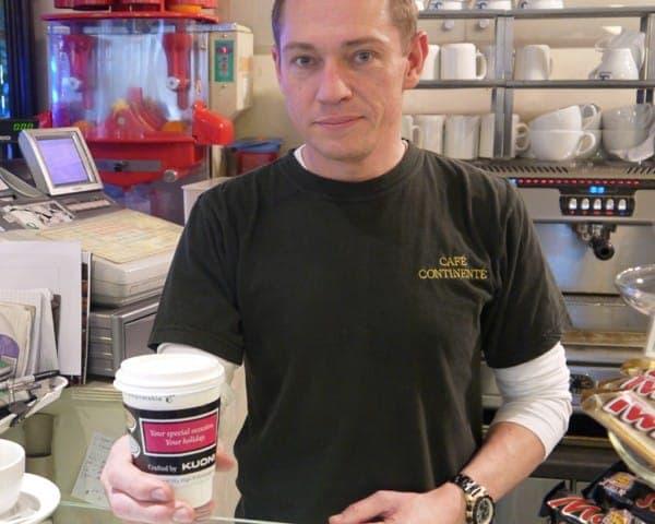 kuoni coffee sleeve coffee cup advertising media