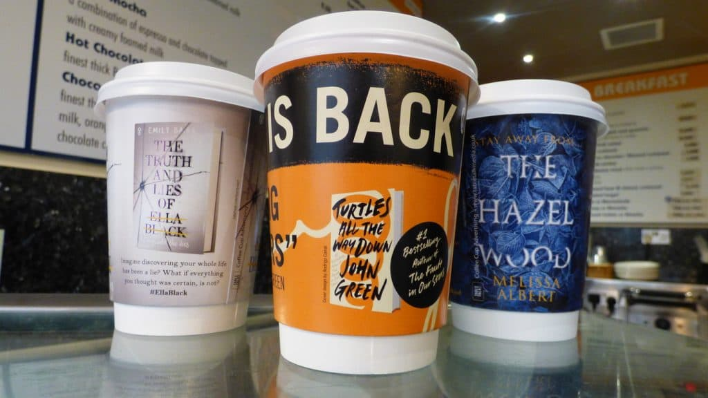 Penguin Young Adult Coffee Cup Advertising
