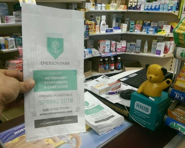 Cinnamon Care Collection pharmacy bag advertising