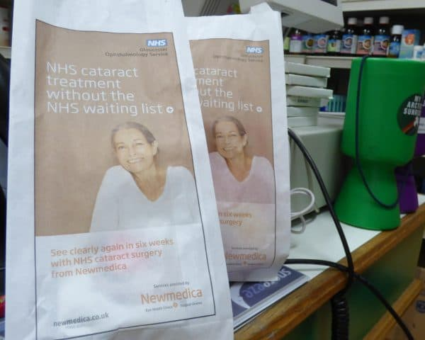 Newmedica pharmacy bag advertising